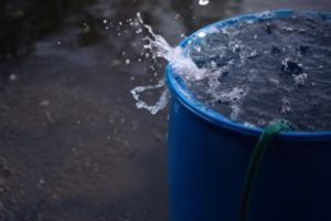 water splashing in a barrel