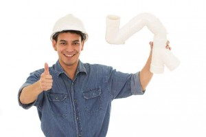 man holding a piece of pipe and giving a thumbs up