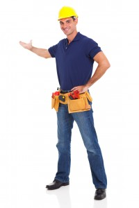 Male plumber wearing a hard hat and tool belt