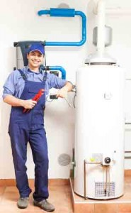 Plumber standing next to a water heater