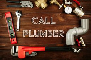 "the words ""call plumber"" surrounded by plumbing tools"