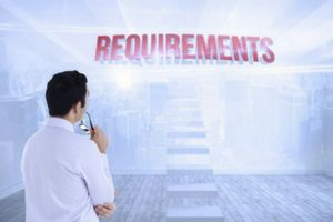 "Man staring at a sign that says ""requirements"""