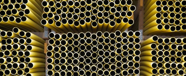 stacks of yellow pipes