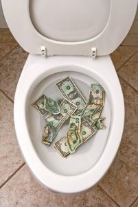 Money in a toilet bowl